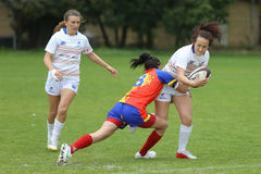 Tackle during female rugby game Royalty Free Stock Images