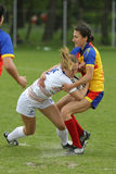 Tackle during female rugby game Stock Photography