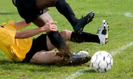 Tackle at football Royalty Free Stock Images