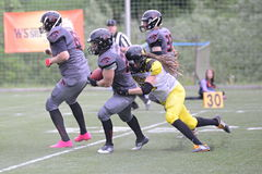 Tackle. JIHLAVA 29/05/2016 _ 5.round of Czech Football League Division IV between the teams and Vysocina Gladiators and Zlín Golems royalty free stock images