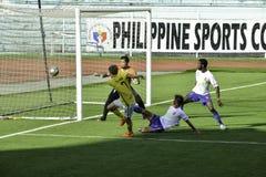 Tackle near the net- Kaya vs Stallions - Manila Football United League Philippines Royalty Free Stock Photos