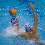 Tackle in a Water Polo Match. Game action during a water polo match stock photo