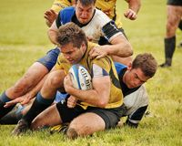 Tackled Down. Ontario Rugby League game at Fletcher's Field Markham Royalty Free Stock Images