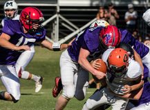 Tackled. Football players in action at the Lion's All Star Game in Redding, California Royalty Free Stock Image
