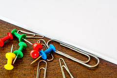 Tacks, clips and paper on the table Royalty Free Stock Image