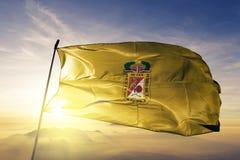 Tacna Region of Peru flag textile cloth fabric waving on the top sunrise mist fog. Beautiful royalty free stock image