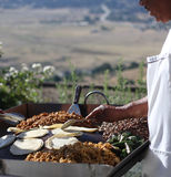 Taco bar. A cook outside making tacos from beef, beans, rice and tortillas stock photo