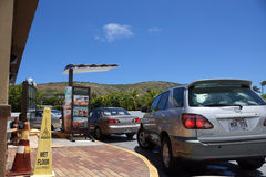 Taco Bell drive thru line of cars wait to order food. HONOLULU - AUGUST 24: Taco Bell drive thru line of cars wait to order food on August 24, 2014 in Hawaii Kai Stock Photos
