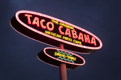 Taco Cabana Restaurant Logo. DALLAS, Tx, USA - APR 17, 2016: Taco Cabana Mexican fast food restaurant logo illuminated at night. Dallas, Texas, United States Royalty Free Stock Photo