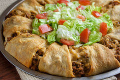 Taco Croissant Ring. Dinner with lettuce and tomato Stock Photo