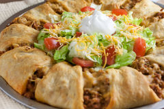 Taco Croissant Ring. Dinner with lettuce and tomato Stock Photography
