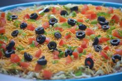 Taco Dip. This is some taco dip with olives, green onions, tomatoes, cheese and beans Royalty Free Stock Photos