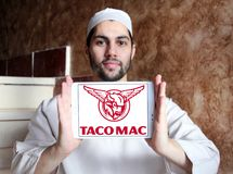 "Taco Mac restaurants logo. Logo of Taco Mac restaurants on samsung tablet holded by arab muslim man. Taco Mac offers the most ""Craft on Draft` with over 100 Royalty Free Stock Photo"
