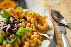 Taco Macaroni and Cheese. Fancy taco macaroni and cheese with black beans jalapenos and white cheddar stock photo