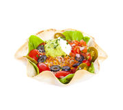 Taco salad. In a baked tortilla on white background Stock Image