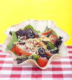 Taco salad on checkered tablecloth Royalty Free Stock Images