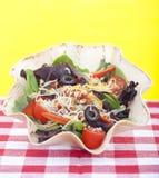 Taco salad on checkered tablecloth. A Taco salad on checkered tablecloth Royalty Free Stock Images
