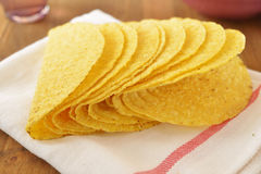 Taco shells. Crusty taco shells on a rustic table Royalty Free Stock Image