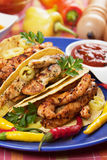 Taco shells filled with chicken meat Stock Images