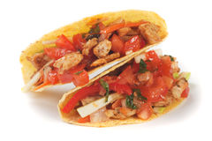 Taco shells. Filled with grilled chicken meat and fresh vegetable salad Royalty Free Stock Photography