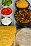 Taco & toppings. Hard & soft shell tacos along with toppings stock photo