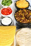Taco & toppings on white. Hard & soft shell tacos along with toppings stock image