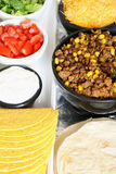 Taco & toppings on white upclose. Hard & soft shell tacos along with toppings stock images