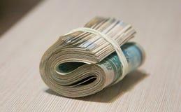 Taco torcido del dinero, el embalar del billete de banco fotografía de archivo libre de regalías