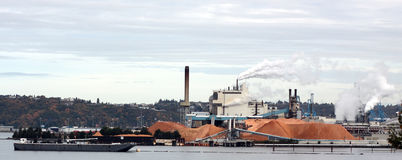 Tacoma Air Quality. Air pollution in Tacoma caused by emissions pouring from smokestacks in industrial district stock images