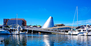 Tacoma downtown marina with Glass Museum, boats and bridge. Royalty Free Stock Photo