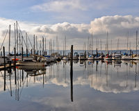 Tacoma marina. Scenic view of boats moored in Tacoma marina with cloudscape background, Washington, America Royalty Free Stock Image