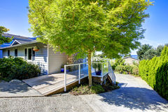 Tacoma real estate. House with wrap-around screened walkout deck. House with wrap-around screened walk-out deck and driveway view Royalty Free Stock Photos
