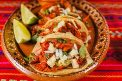 Tacos al pastor and lemon mexican spicy food in mexico city. Tacos al pastor mexico lemons mexican food tortilla, spicy mexico city Royalty Free Stock Images