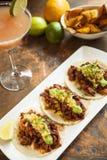Tacos al Pastor. With a mango margarita royalty free stock image