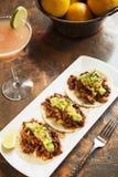 Tacos al Pastor. With a mango margarita stock image