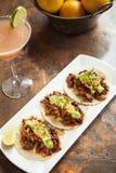 Tacos al Pastor. With a mango margarita royalty free stock photography