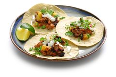 Tacos al pastor, mexican food. Isolated on white background stock image