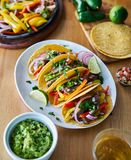 Tacos with beef and bell pepper filling served with guacamole royalty free stock photos