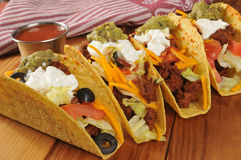 Tacos. Beef tacos with sour cream, guacamole and cheddar cheese stock photography
