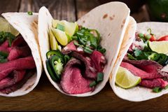 Mexican tacos with beef steak and vegetables Royalty Free Stock Photo