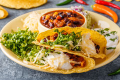 Tacos with chili con carne, salad, cheese and sour cream. Royalty Free Stock Image