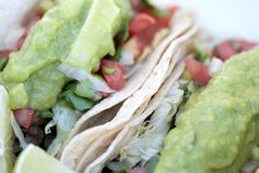 Tacos. Close up of tacos with soft tortillas vegetables and guacamole stock photo