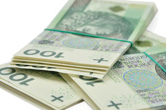 Tacos de 100 billetes de banco de PLN aislados en blanco Imagenes de archivo