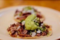 Tacos de carne asada with guacamole royalty free stock photo