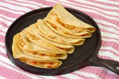 Tacos on Griddle. Mexican chicken tacos served on warm antique cast-iron griddle stock image