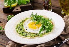 Tacos with guacamole, fried egg and arugula. Healthy food. Useful breakfast royalty free stock photography