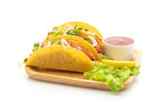 Tacos with meat and vegetables isolated on white background. Mexican food style royalty free stock image