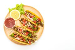 Tacos with meat and vegetables isolated on white background. Mexican food style stock photos