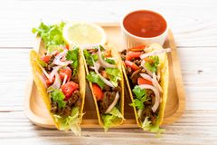 Tacos with meat and vegetables. Mexican food style royalty free stock image