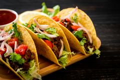 Tacos with meat and vegetables. Mexican food style royalty free stock images